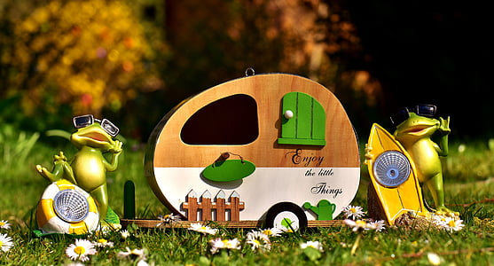 trailer with frog figurines garden decors