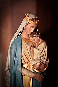 shallow focus photography of Virgin Mary statuette
