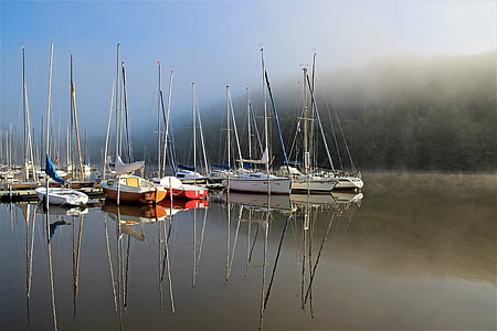 assorted sailboats on body of water