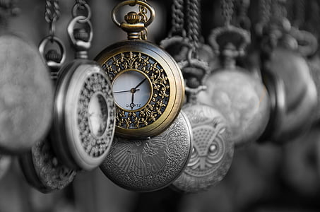 closeup photo of silver-colored pocket watch lot