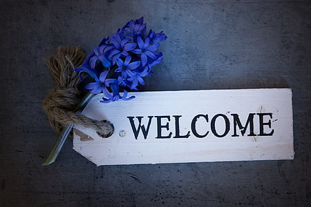 white Welcome signage decor