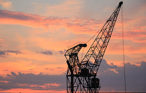 black metal crane at sunset