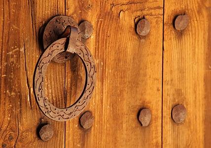 brown metal door knocker