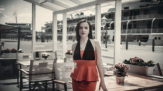woman wearing red and black halter dress during daytime
