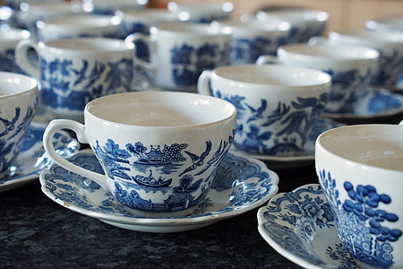 blue and white ceramic cup and saucers set