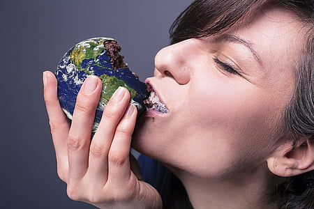 woman eating chocolate globe pastry
