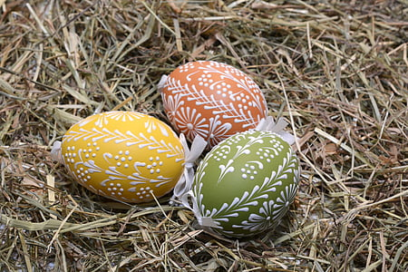 three yellow and green Eggs