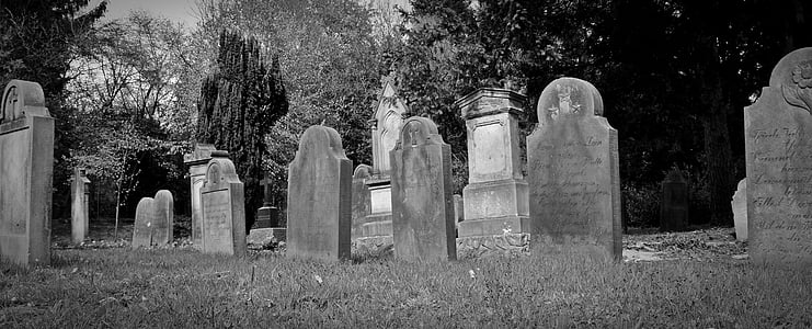 grayscale of photo of tomb stone