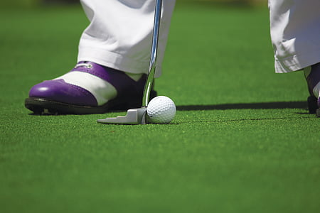 person wearing purple-and-white shoes while playing golf