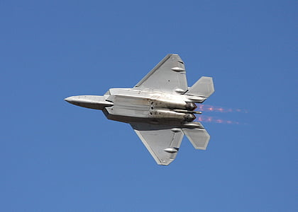 white fighter plane flying in the sky