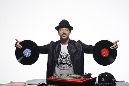 man holding two vinyl records