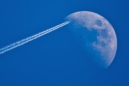 jet plane view with moon