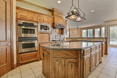 brown wooden kitchen isle