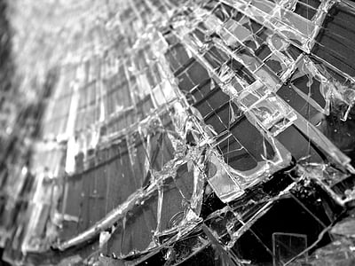 grayscale close up photography of crushed glass