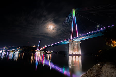 concrete bridge with blue and pink lights