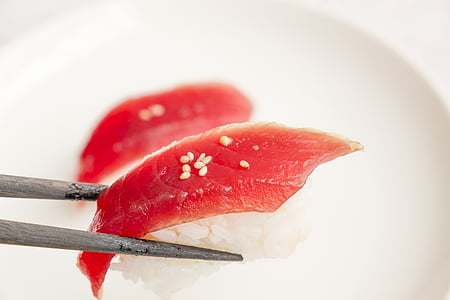 chopstick with sushi