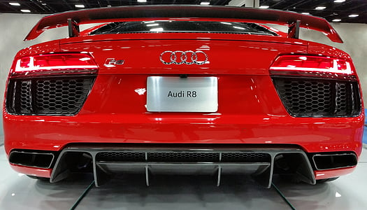 red Audi coupe on white flooring