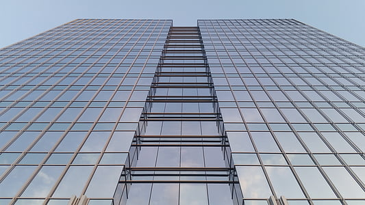 glass building under gray sky