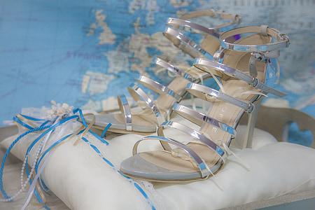 closeup photo of heeled sandals on pillow