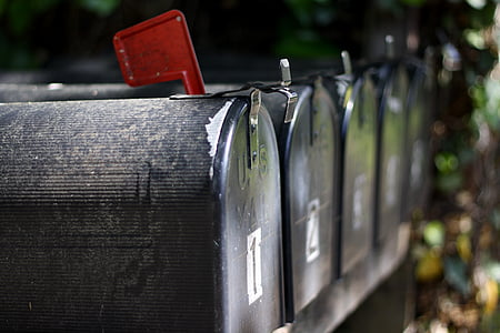 close up photo of black mailboxes