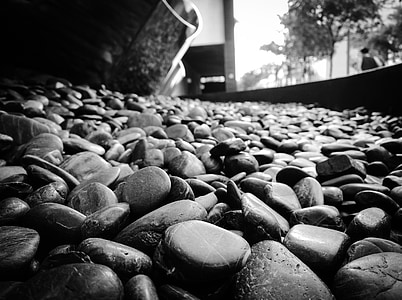 grayscale photo of stones
