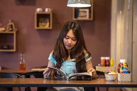 woman reading on book