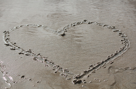heart drawn on sand