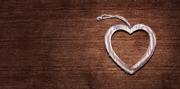 silver heart decor on brown surface