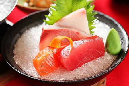 raw fish on bowl of salt