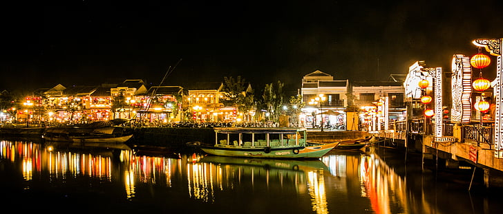 boats park on marina during nighttime