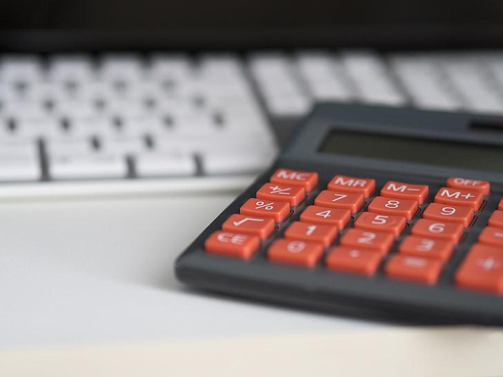 gray and orange desk calculator