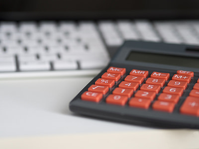 gray and orange desk calculator