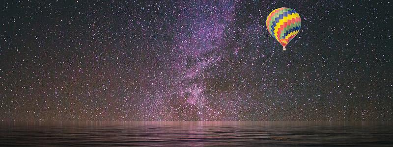 hot air balloon under starry sky