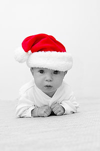 gray scale photo of baby wearing Santa hat