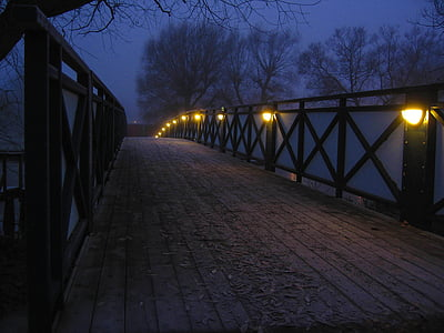 brown and black wooden bridge during nighttime