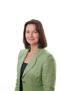 woman wearing green notched lapel suit jacket