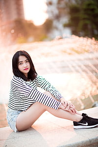 selective focus shot of woman sitting