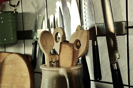 ladle in pitcher near kitchen knife