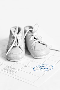 gray leather lace-up shoes on white planner