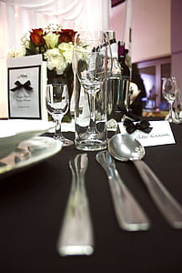 silver spoon and knives on table