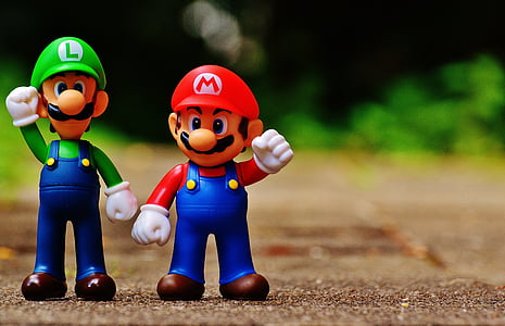 selective focus photography of Super Mario and Luigi figurines