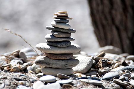 selective focus photograph of balance stones