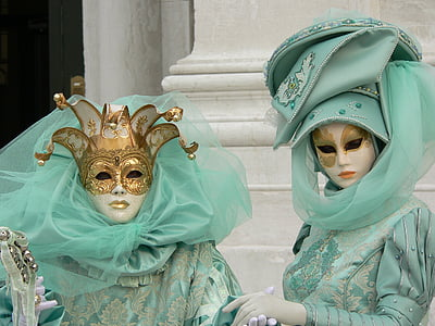 two person wearing masquerade masks