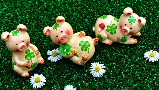 three pink ceramic pig figurines