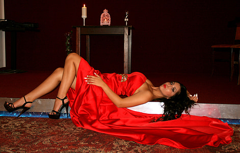 woman wearing red sleeveless dress