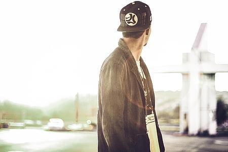 man wearing black coat and cap