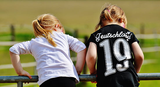 two girls wearing white and black shirts