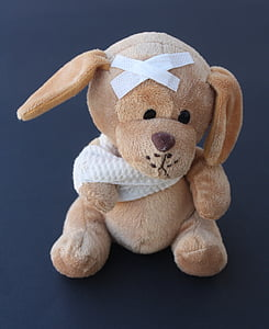 brown puppy with bandage plush toy