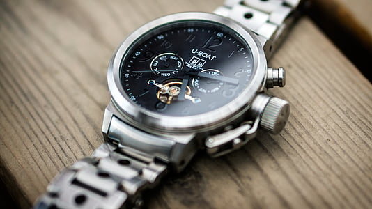 selective focus photography of round black U-Boat chronograph watch with at 5:15