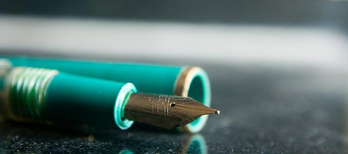 closeup photo of fountain pen